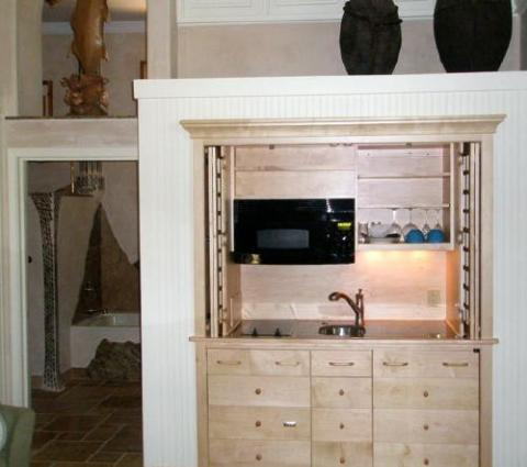 Here A Natural Maple Armoire Kitchen Has Been Built Into A Wall In An  Extended Stay Guest Suite At A Tropical Beach Hotel. The Grid Door Design  Features ...